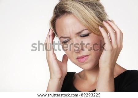woman with a big headache shot in the studio - stock photo