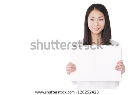 Woman with a blank sketchbook - stock photo