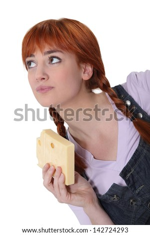 Woman with a block of Swiss cheese - stock photo