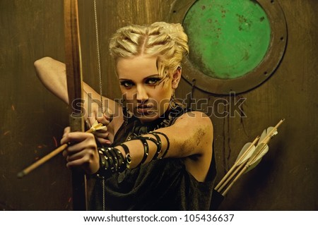 Woman with a bow in a bunker - stock photo