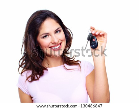 Woman with a car keys. Isolated on white background. - stock photo