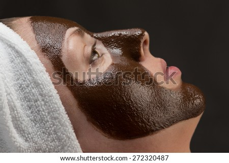 woman with a chocolate face-pack - stock photo