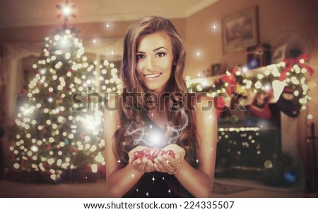 Woman with a Christmas Gift - stock photo