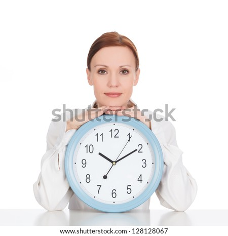 Woman with a clock against white background - stock photo