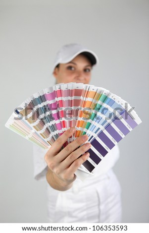 Woman with a color swatch - stock photo