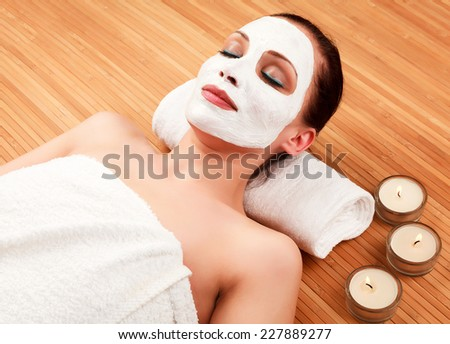Woman with a cream on her face  - stock photo