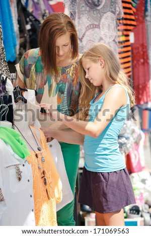 woman with a  daughter shopping in an european city - stock photo