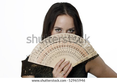 Woman with a fan in her hand - stock photo
