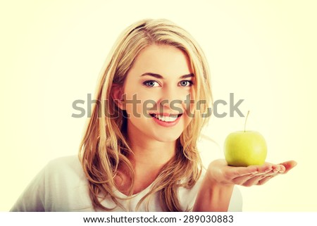 Woman with a fresh green apple - stock photo