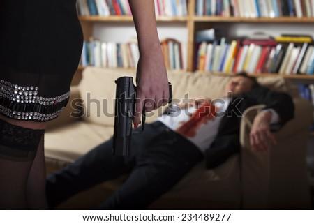 woman with a gun  - stock photo