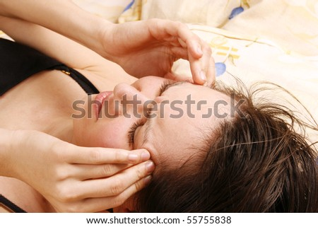 Woman with a headache in the morning - stock photo