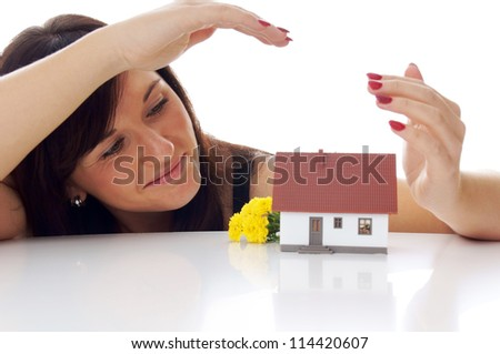 woman with a little house / dream of own house - stock photo