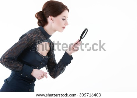 woman with a magnifying glass - stock photo