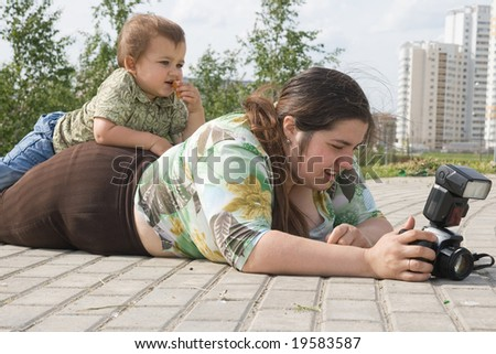 Woman with a photo camera and her son - stock photo