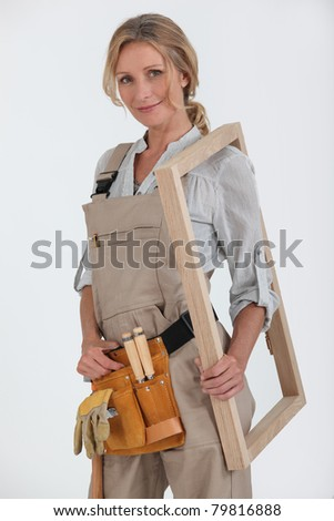 Woman with a picture frame. - stock photo