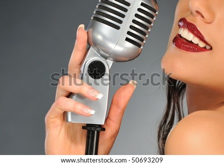 Woman with a retro microphone - stock photo