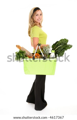 Woman with a shopping bag filled with nutritious fruit and vegetables, - stock photo