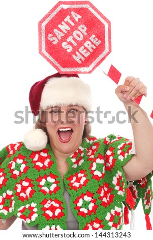 Woman with a sign that reads Santa Stop Here - stock photo