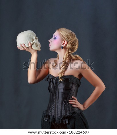 Woman with a Skull. Shakespeare's Hamlet, female version - stock photo