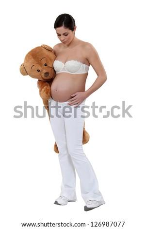 Woman with a teddy bear - stock photo
