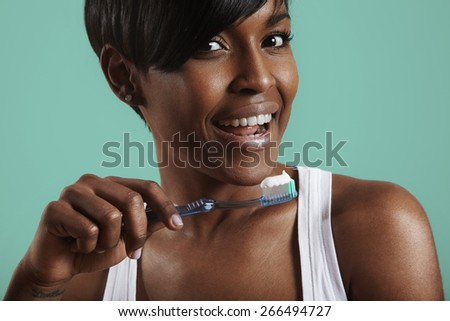 woman with a teeth brush and a tooth paste on it - stock photo