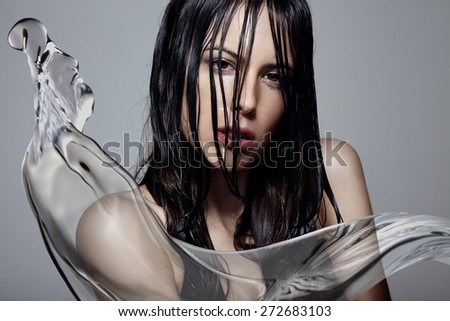 woman with a wet hair and water splash - stock photo