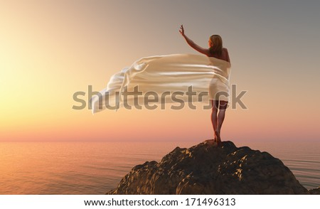 woman with a white tissue on the morning beach - stock photo