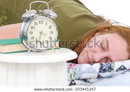 Woman with an alarm clock - stock photo