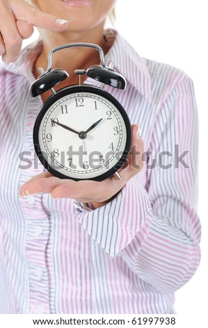 woman with an alarm clock in a hand. Isolated on white background - stock photo