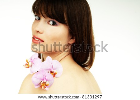 woman with an orchid - stock photo