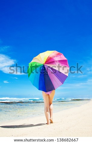 Woman with an umbrella - stock photo