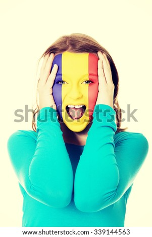 Woman with Andora flag painted on her face. - stock photo