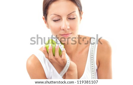 Woman with apple and measure tape, isolated on white. Healthy life - stock photo