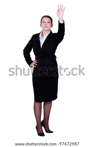 Woman with arm raised - stock photo