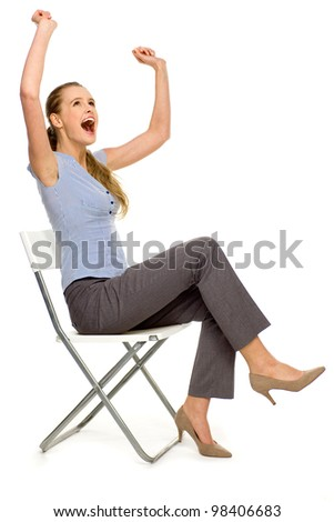Woman with arms raised - stock photo
