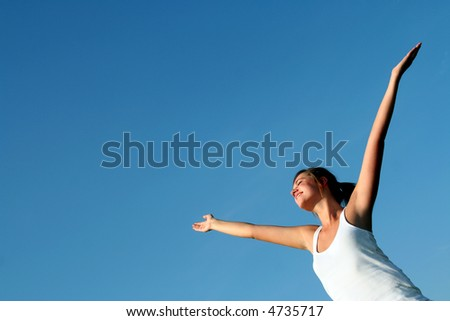 Woman with arms wide open - stock photo