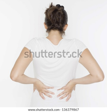 woman with back problems - stock photo