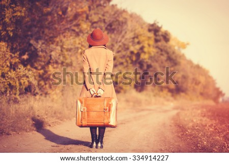 woman with bag at countryside in autumn time - stock photo