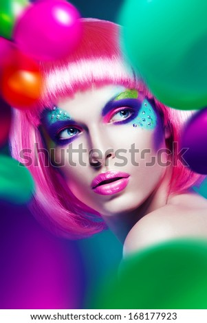 woman with balloons around - stock photo