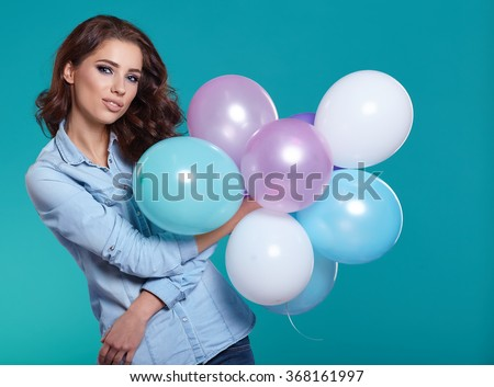 Woman with balloons in studio  - stock photo