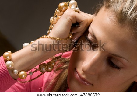 Woman with beads necklace closeup portrait - stock photo