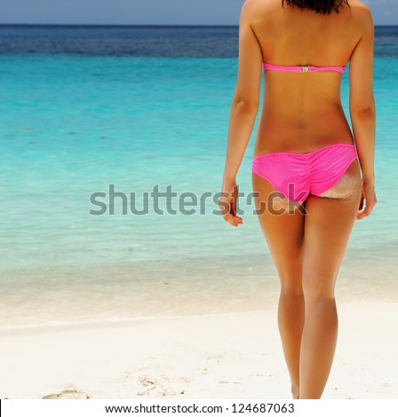 Woman with beautiful body at beach - stock photo