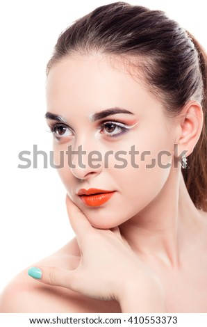 Woman with beautiful face on white background. Woman with color makeup. - stock photo