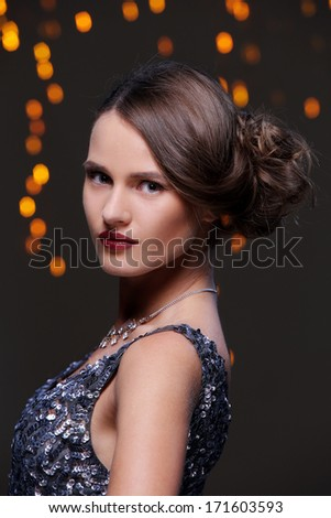 Woman with beautiful hairstyle at new year party celebration - stock photo