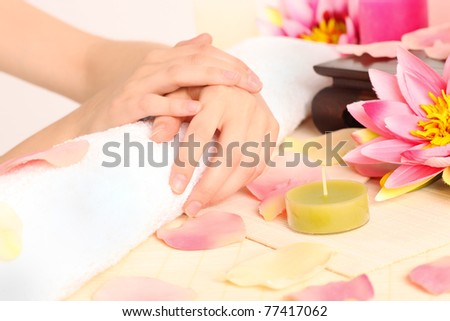 Woman with beautiful hands after a manicure - stock photo