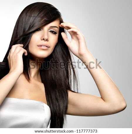 Woman with beauty long straight hair. Pretty young girl with beautiful hairstyle. Creative studio image. - stock photo