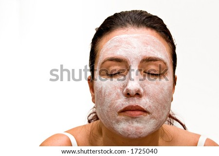 Woman with beauty mask. Isolated on white background - stock photo