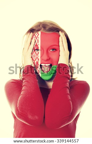 Woman with Belarus flag painted on face. - stock photo