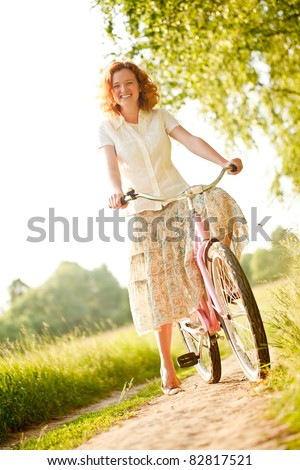 Woman with bicycle - stock photo