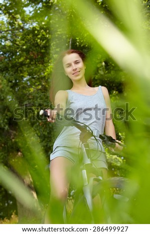 woman with bike - stock photo